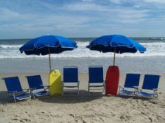 Beach chairs and umbrellas for rent at Just For the Beach Rentals